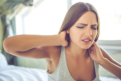 Lady in need of chiropractic care because sleeping wrong gave her neck pain.